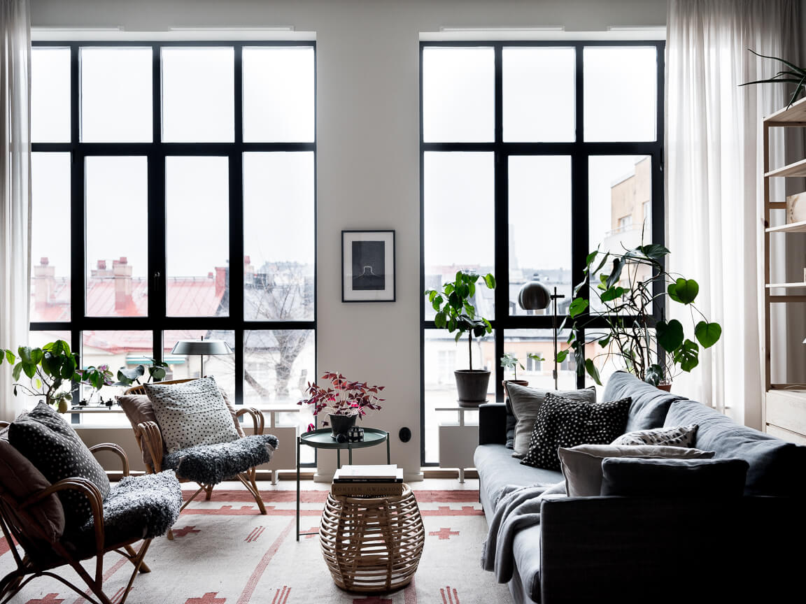 A Scandinavian Apartment With Floor To Ceiling Windows