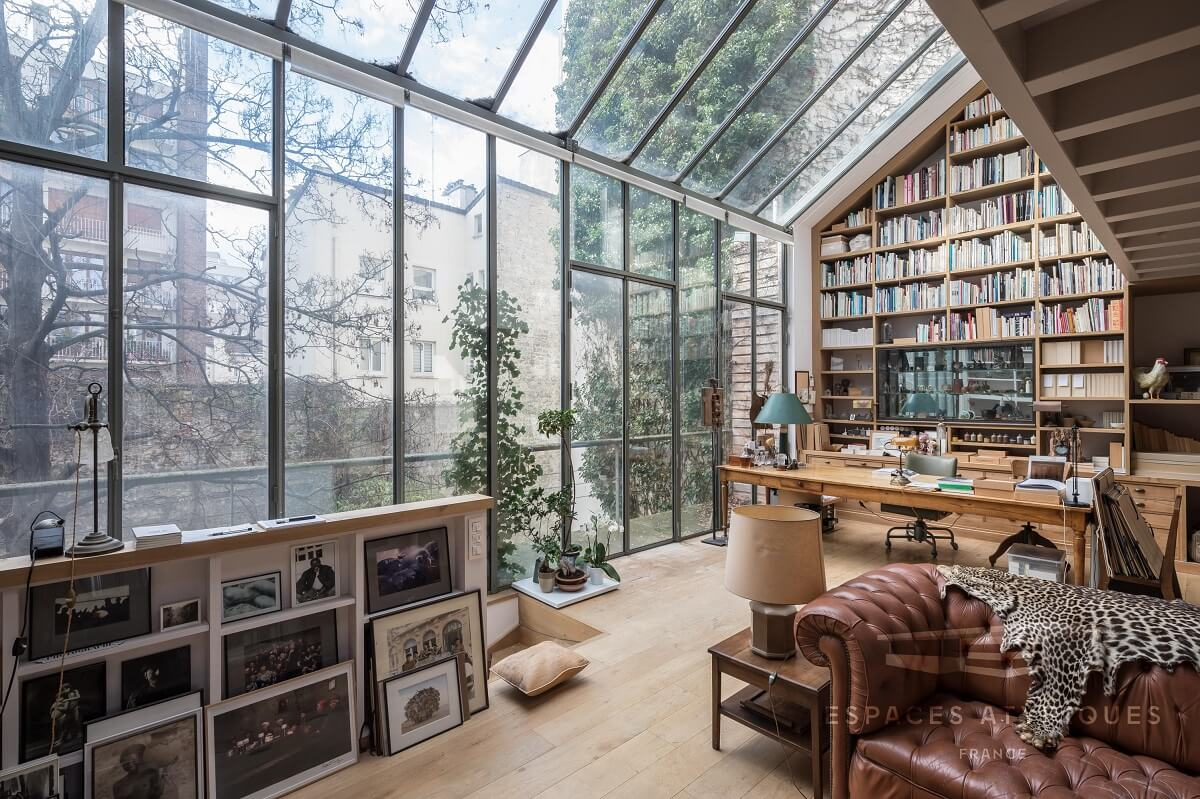 Spectacular Windows In A Serene Book-Filled Oasis in Paris