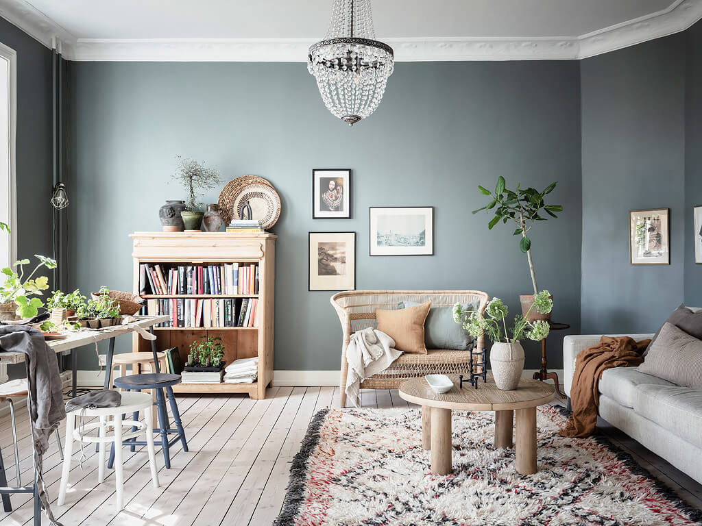 A Charming Swedish Apartment with Blue Walls and Plants