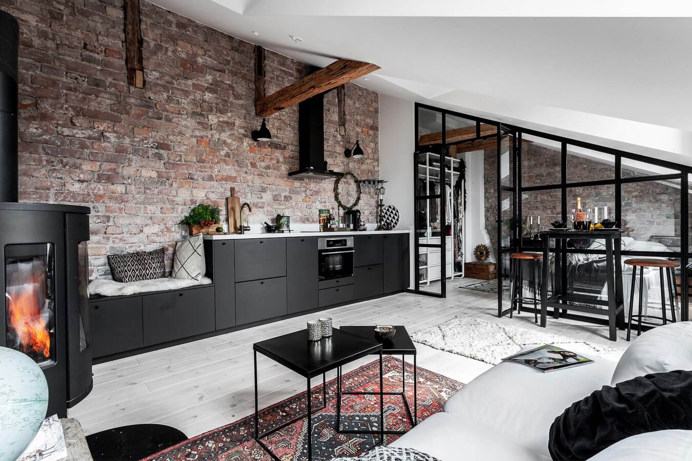 An Industrial Look For A Small Attic Apartment in Stockholm