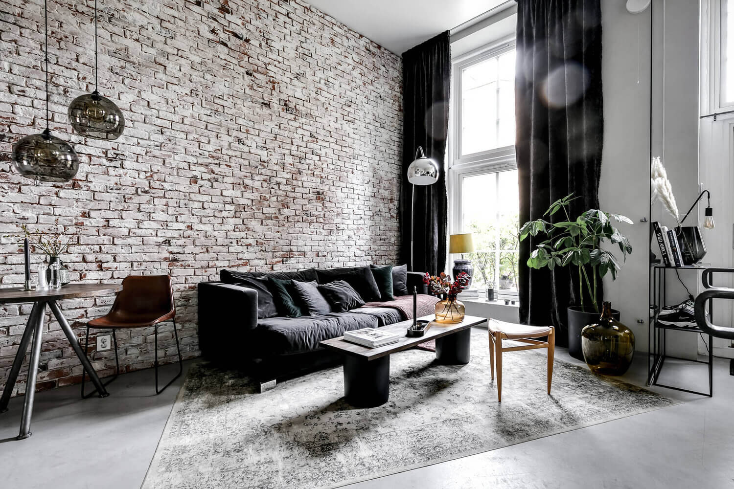 An Industrial Scandinavian Apartment with Exposed Brick Wall