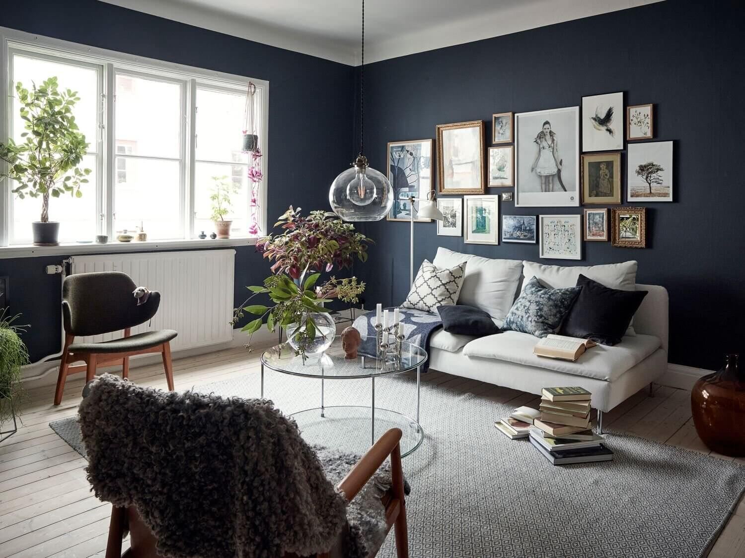 A Cozy Apartment With A Deep Blue Living Room