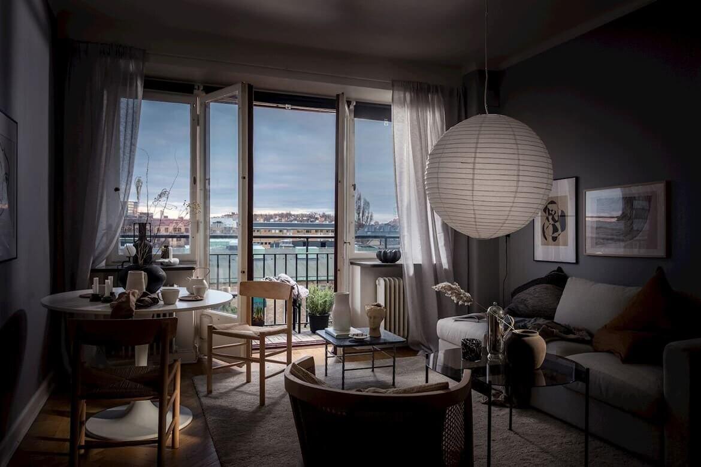 A Small Studio Apartment Decorated in Calm Color Tones