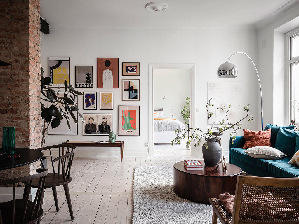 A Scandinavian Apartment with Exposed Brick Wall and Colorful Touches