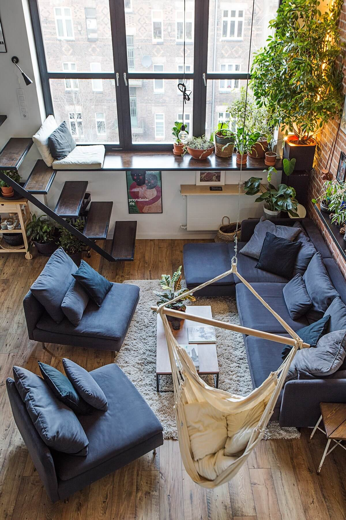 A Creative Loft Apartment in Poland with Exposed Brick and Art