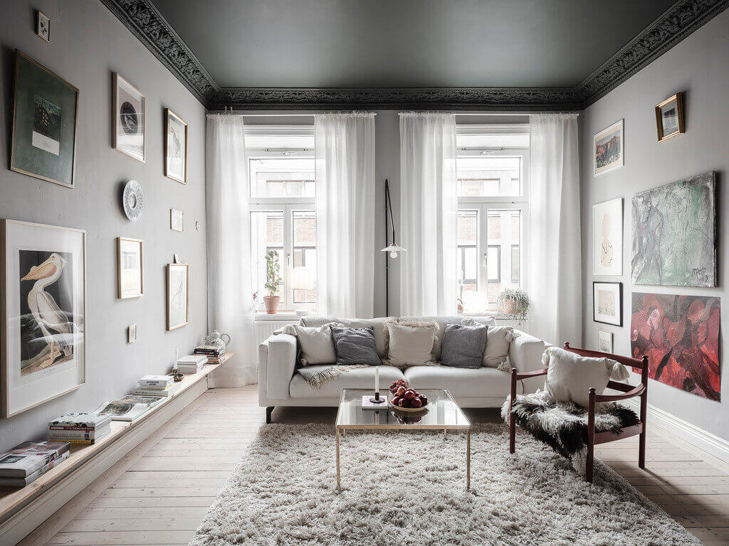 A Dark Green Painted Ceiling In An Art-Filled Apartment