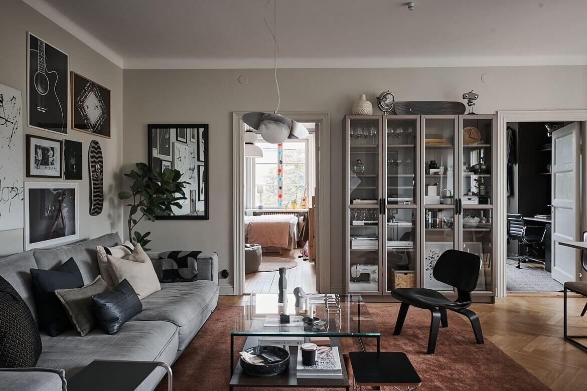 A Grey Scandinavian Apartment with Art-Filled Living Room