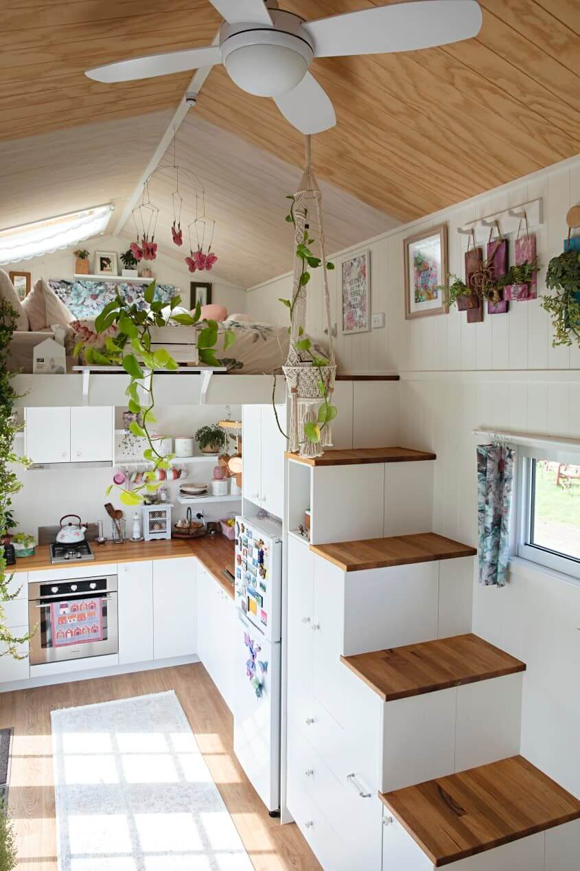 A Light and Plant-Filled Tiny House with Two Sleeping Lofts