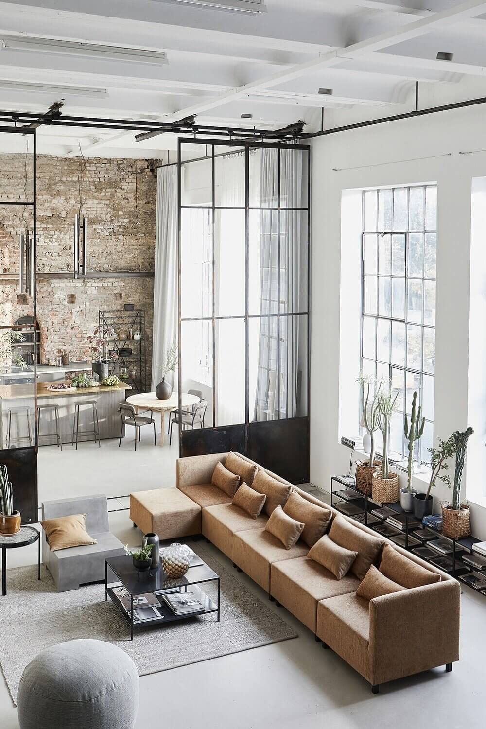 A Bright Industrial Loft Decorated With House Doctor's Spring/Summer Collection