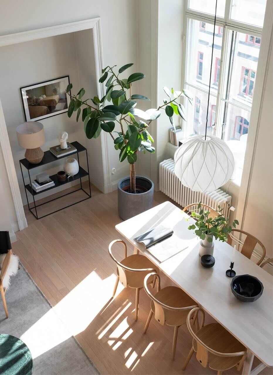 A Scandinavian Loft Apartment with Dark Green Kitchen