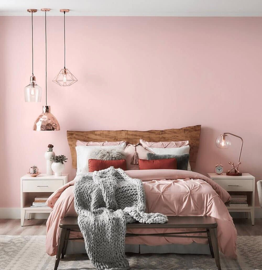 bedroom-pink-wall-wooden-headboard-nordroom