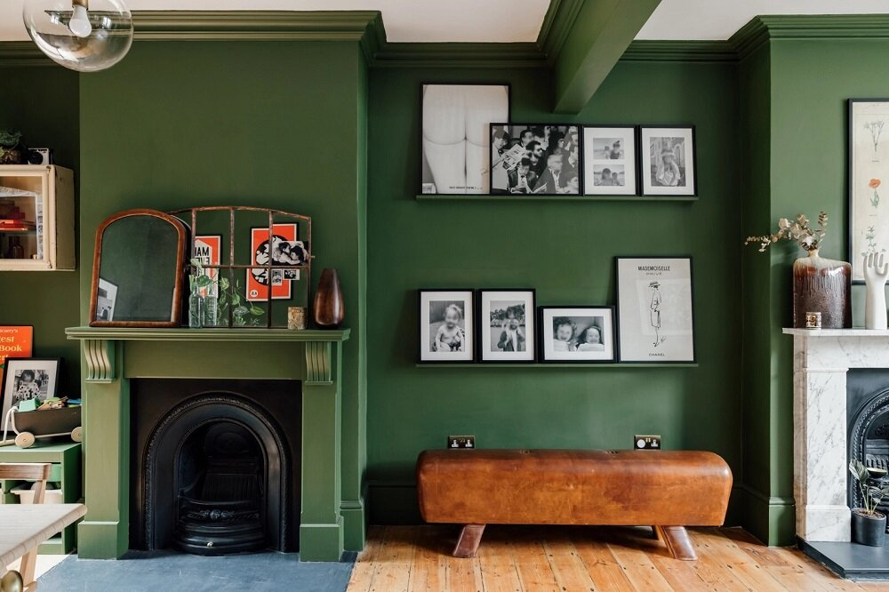 green-living-room-leather-bench-picture-ledge-fireplace-nordroom