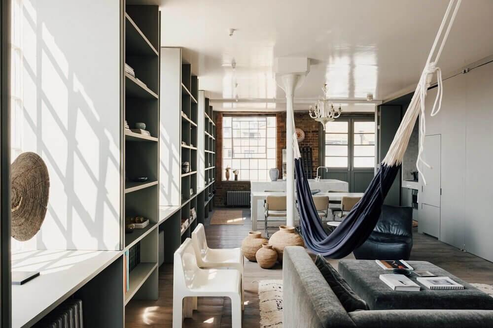 london-loft-ilse-crawford-vincent-van-duysen-grey-bookshelves-hammock-nordroom