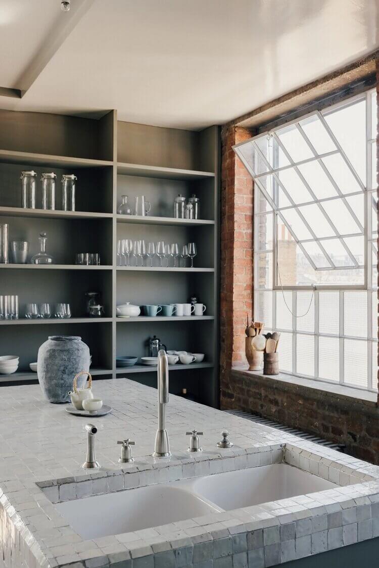 london-loft-ilse-crawford-vincent-van-duysen-grey-bookshelves-kitchen-island--zellige-tiles-brick-wall-victorian-warehouse-conversion-nordroom