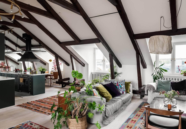 A Scandinavian Penthouse Apartment With A Dark Green Kitchen