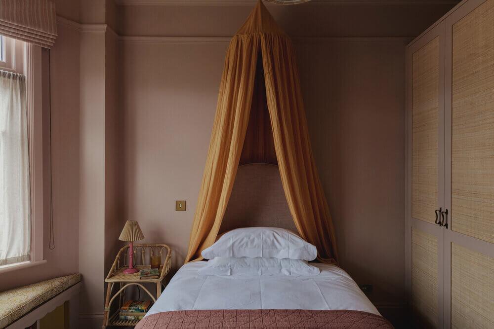 pink-bedroom-yellow-canopy-cane-wardrobe-studio-duggan
