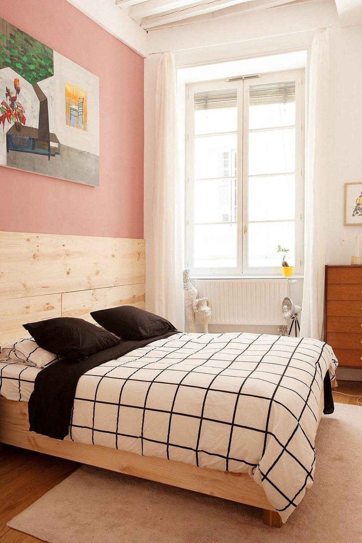 pink-wall-light-wooden-bedframe