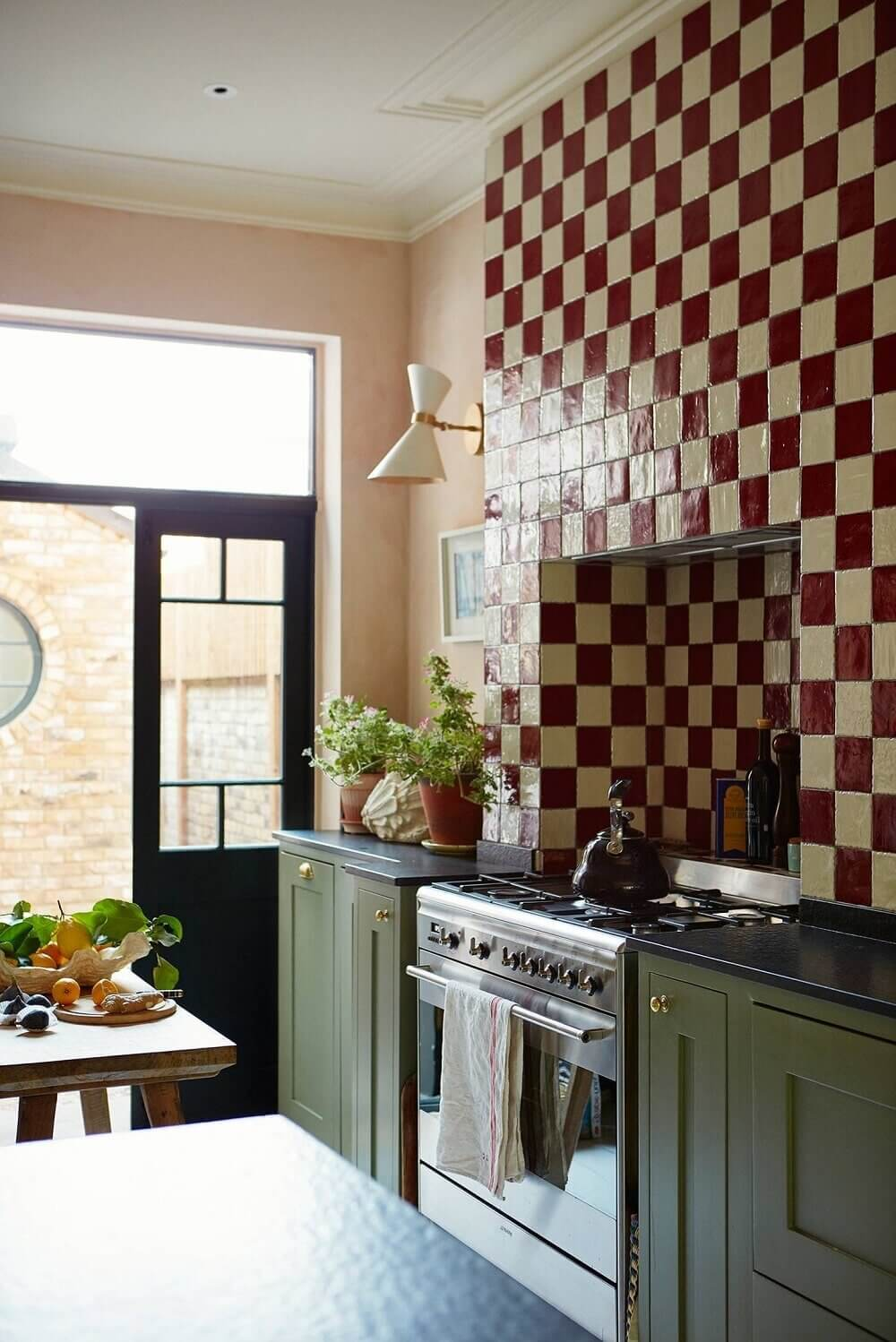 green-kitchen-cabinets-red-white-tiles-pink-walls-nordroom