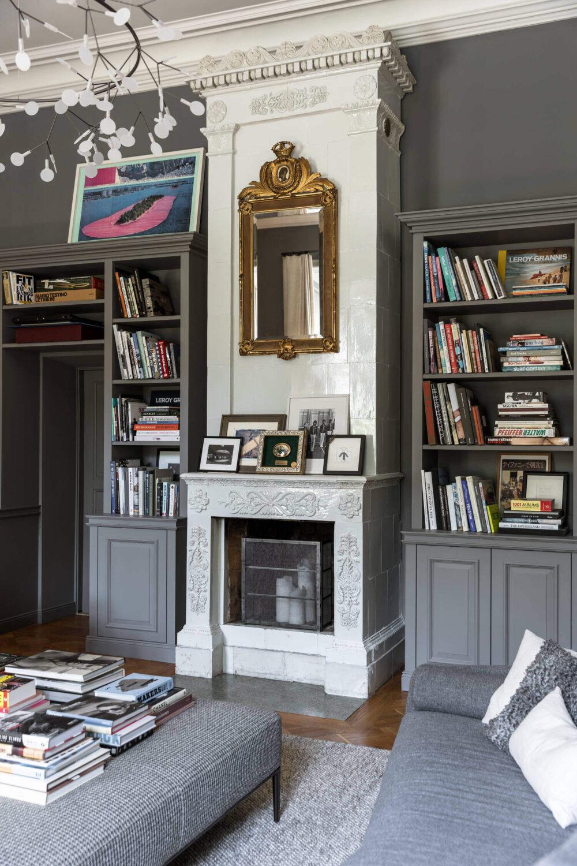 fireplace-bookshelves-gray-apartment-sweden-nordroom