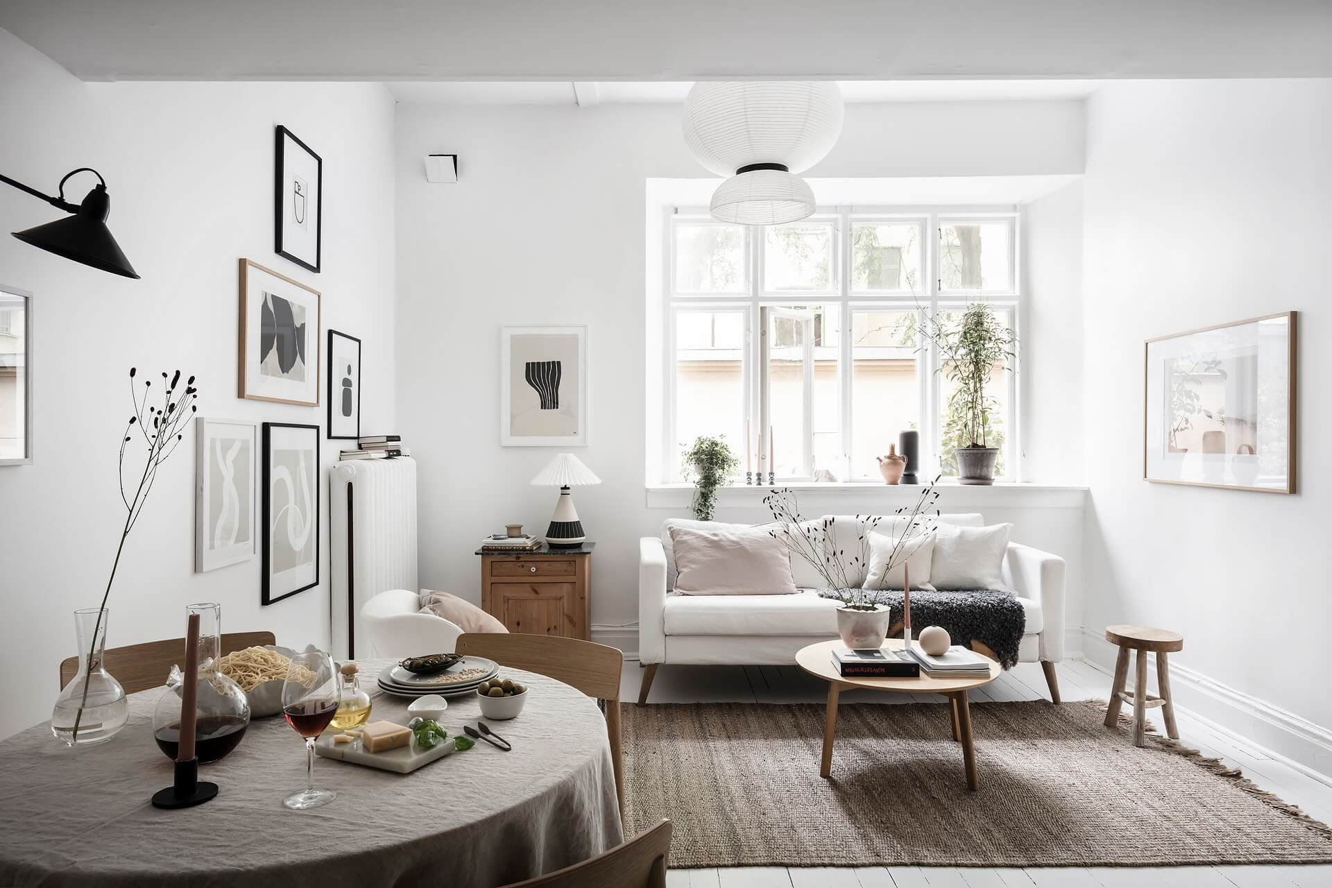 A White Scandinavian Studio Apartment With Loft Bed