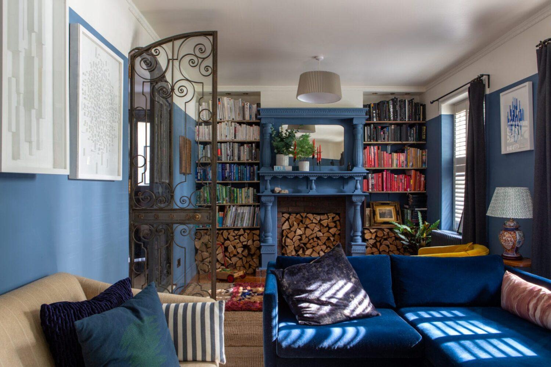 blue-living-room-fireplace-bookshelves-nordroom