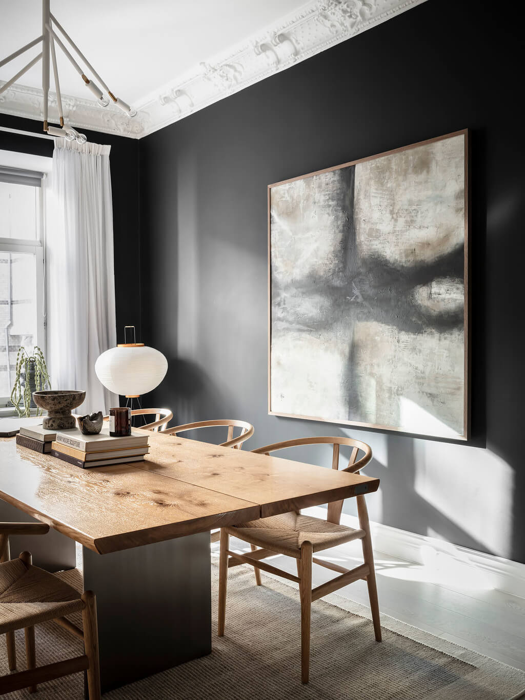A Black Dining Room in a Stylish Apartment